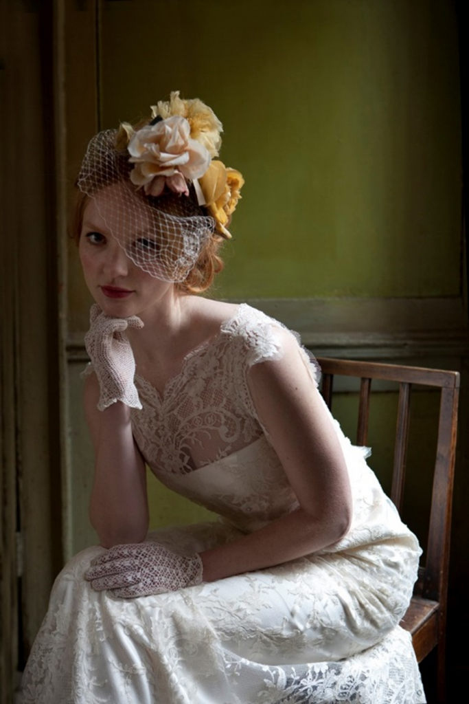 Floral headpiece with vintage millinery flowers and detachable birdcage veil, Cherished. Dress, Emmeline by Sally Lacock. Photographic credit: Jeff Cottenden.