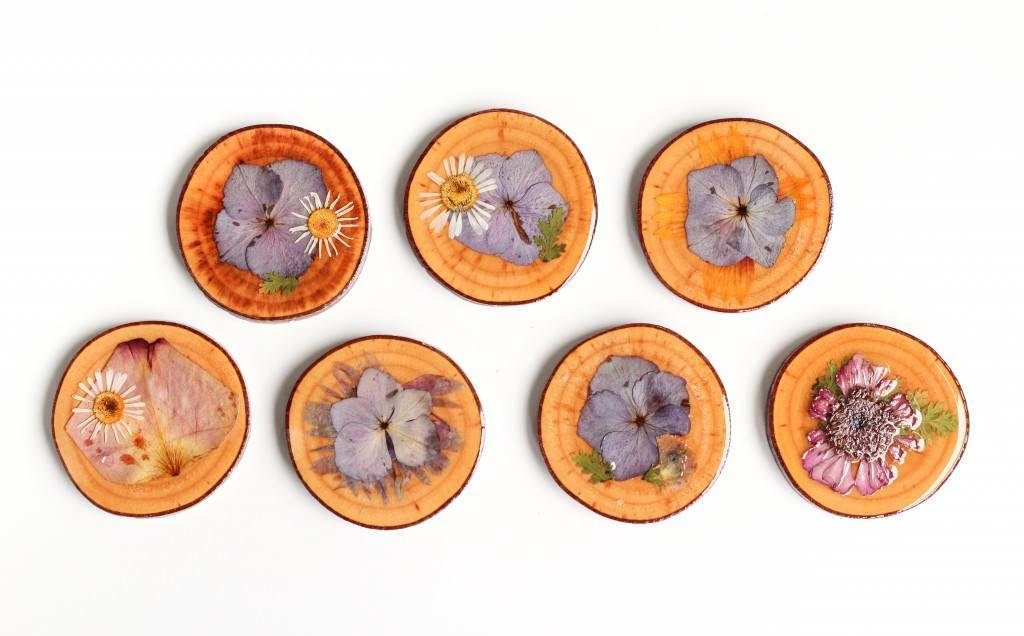 Flowers pressed into coasters as featured on National Vintage Wedding Fair blog