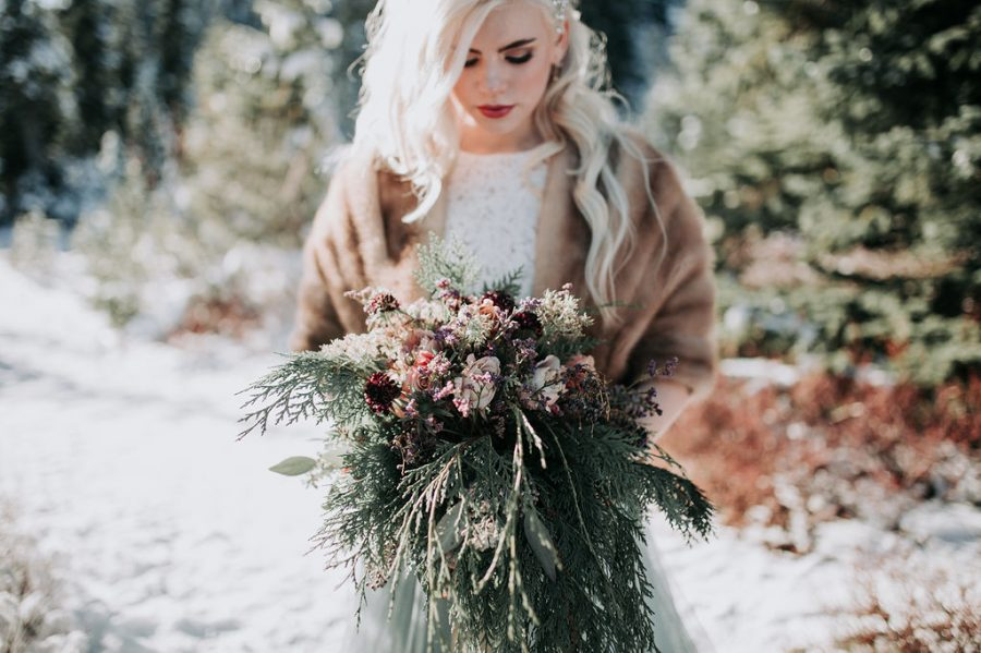 Winter Wonderland Wedding with Blue Wedding Dress and Fur Capelet